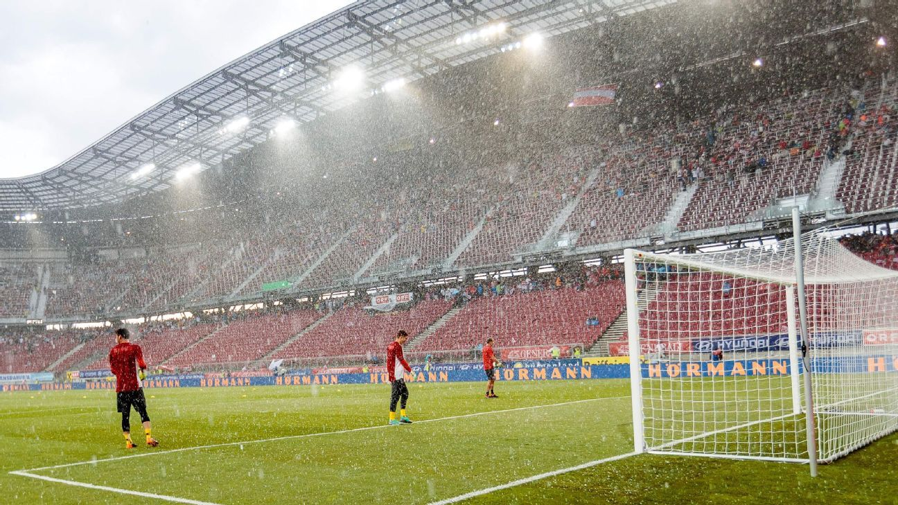 Hailstones fall as a storm passes over prior to Austria v Germany in Klagenfurt.
