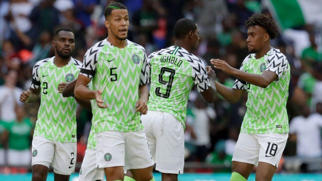 Alex Iwobi, right, celebrates with teammates.