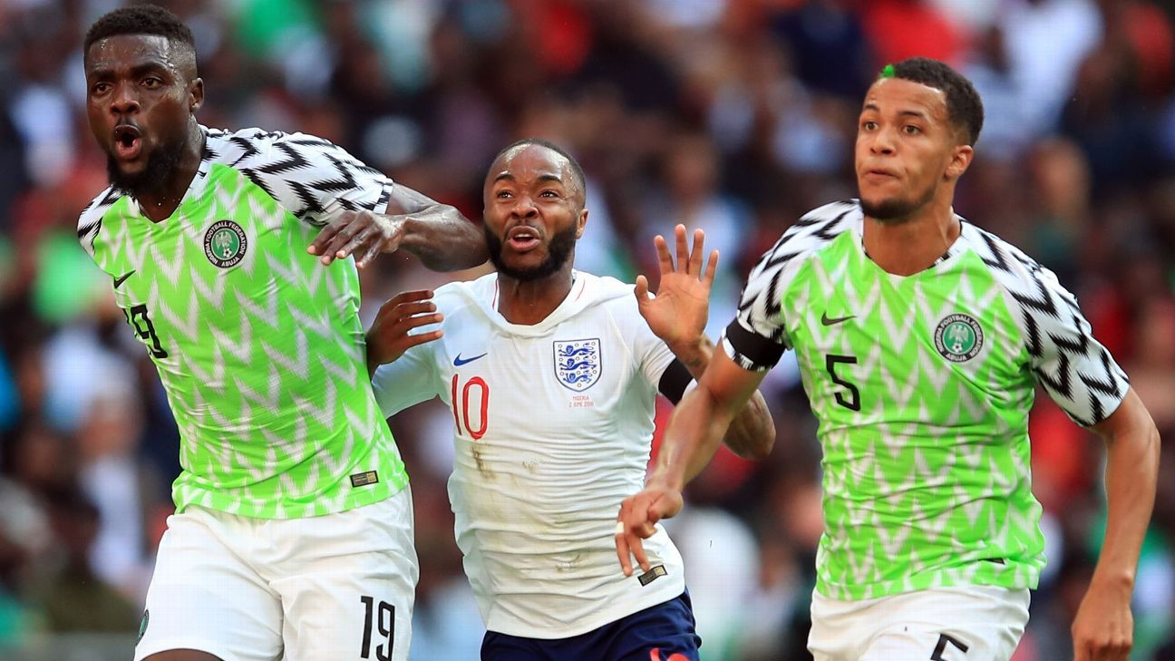Raheem Sterling battles with Joel Obi and William Troost-Ekong.