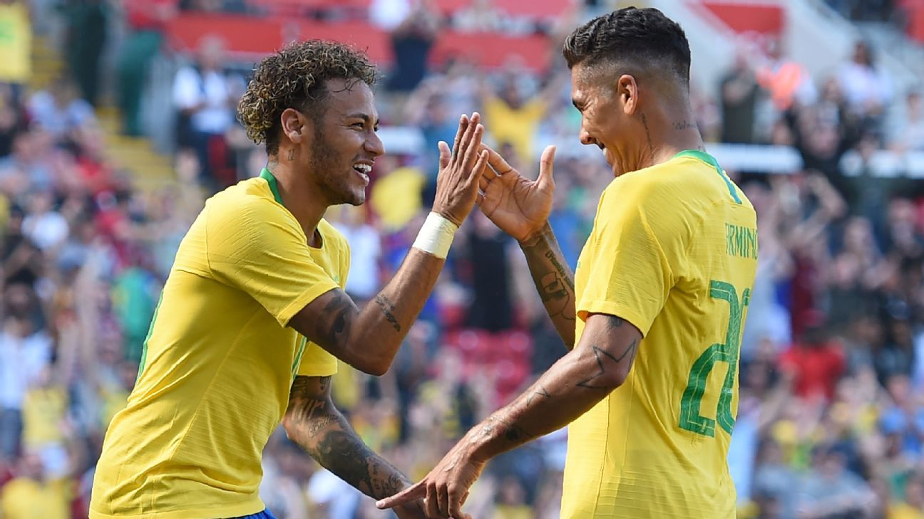 Neymar and Roberto Firmino celebrate a goal during a Brazil warmup game.