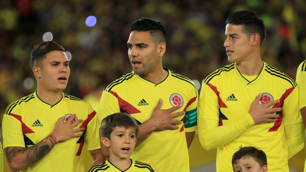Colombia players stand for their national anthem.