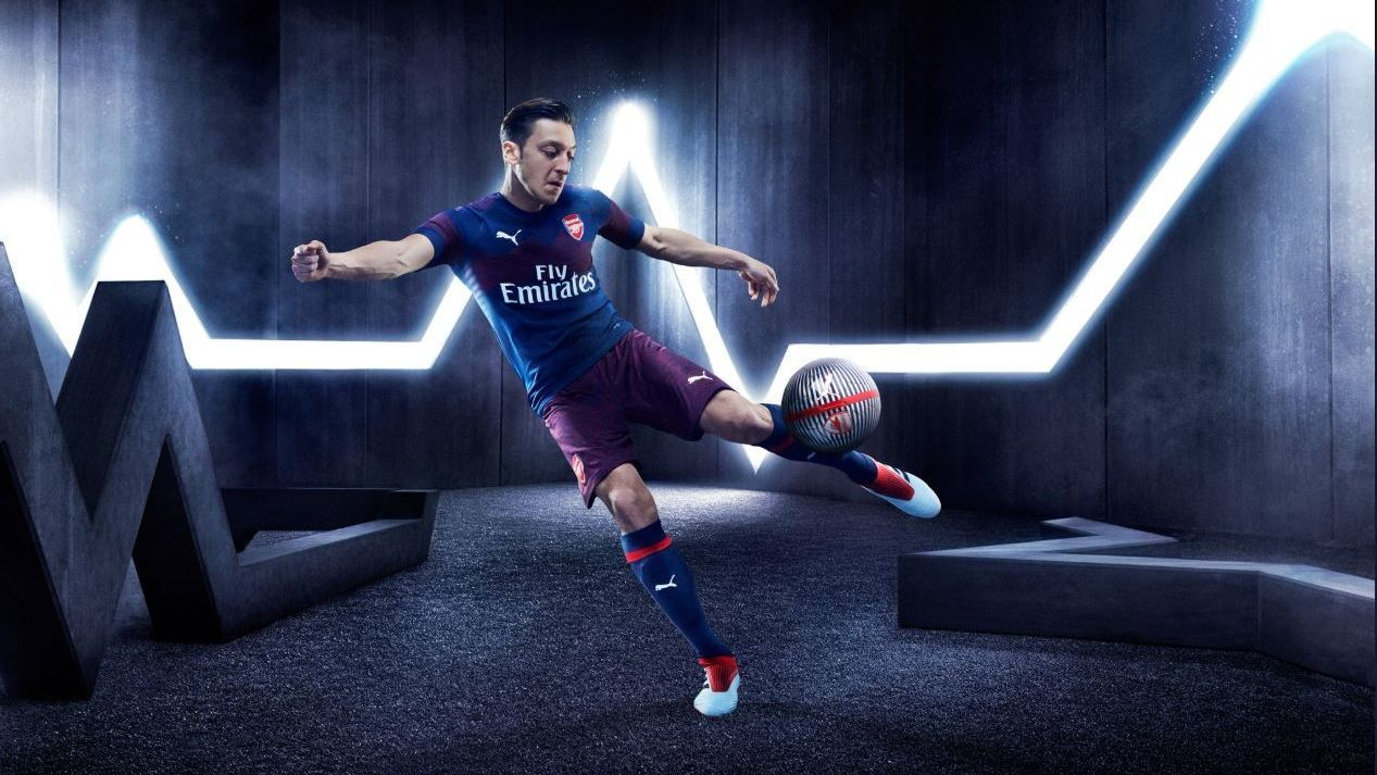 Mesut Ozil models new Arsenal away kit
