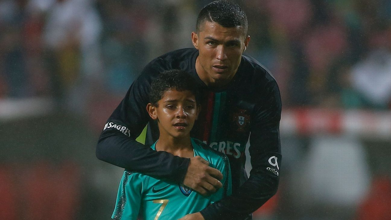 Ronaldo and his son at the Portugal vs. Algeria friendly.