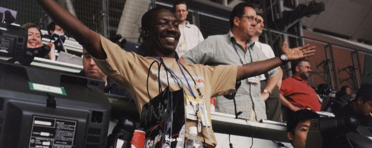 A Senagalese journalist celebrates Senegal's win over France.
