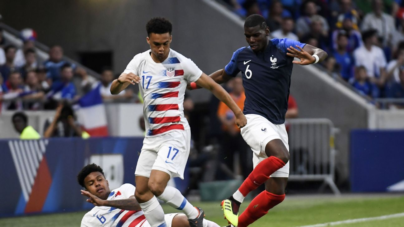 Paul Pogba battles with U.S. youngster Antonee Robinson for possession.
