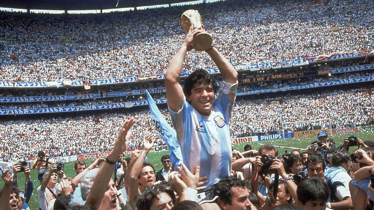 Diego Maradona holds the World Cup trophy aloft after the 1986 World Cup final between Argentina and West Germany in Mexico City.