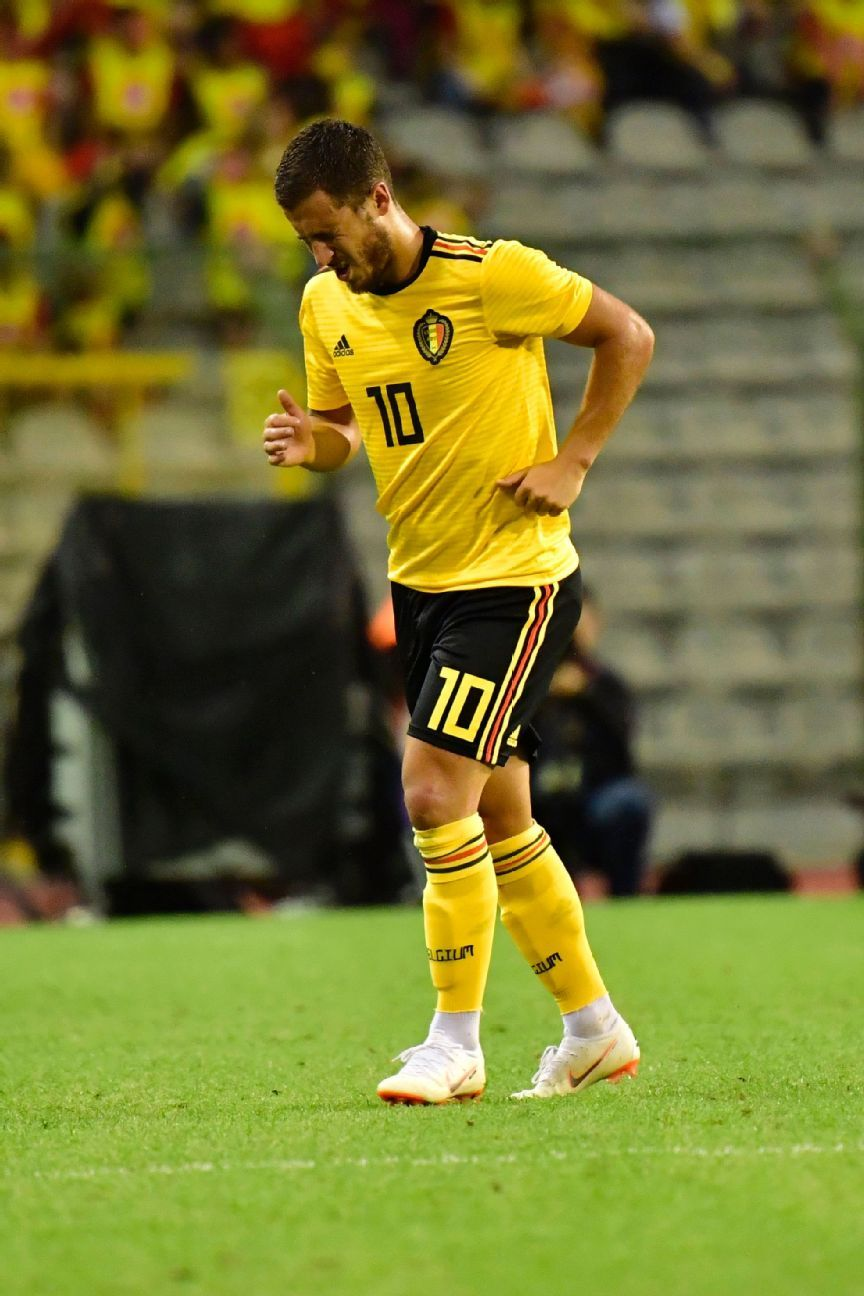 Eden Hazard grimaces after taking a knock against Costa Rica.