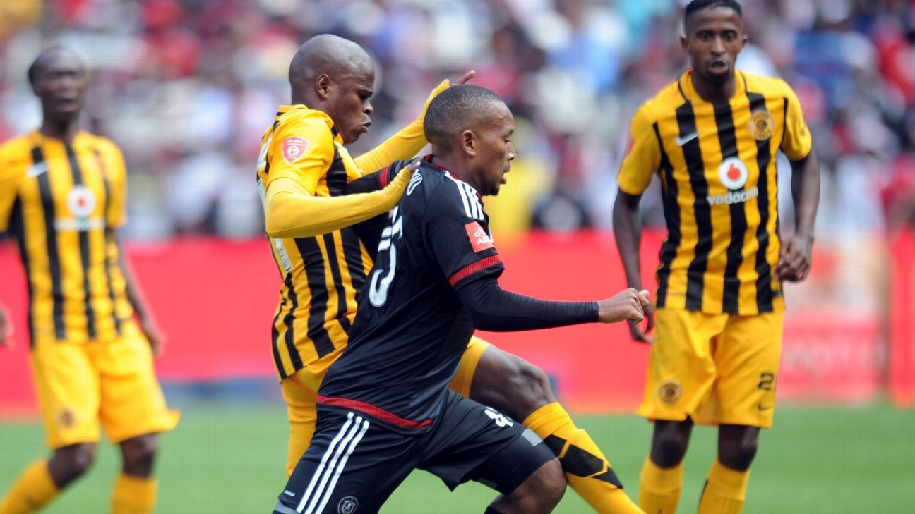 Willard Katsande of Kaizer Chiefs tackles Lehlohonolo Majoro of Orlando Pirates