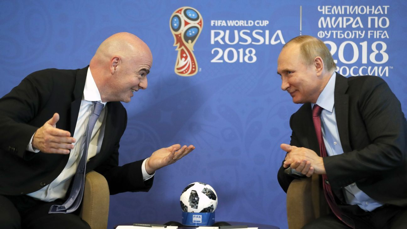 Vladimir Putin, right, is ready to kick off the World Cup party but one senses it won't pass entirely without a lingering sense of concern.