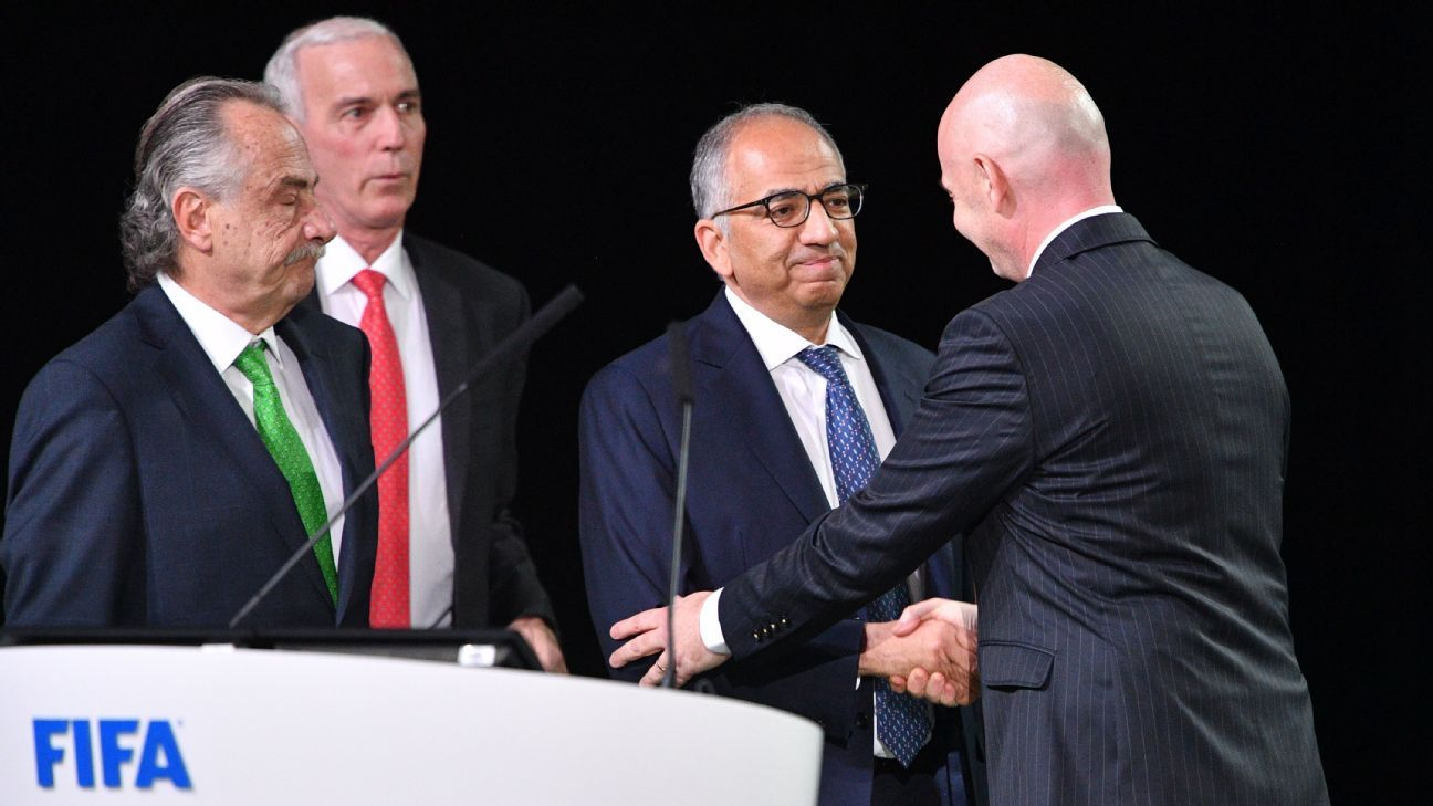 FIFA president Gianni Infantino, right, congratulates the presidents of the three United bid federations.