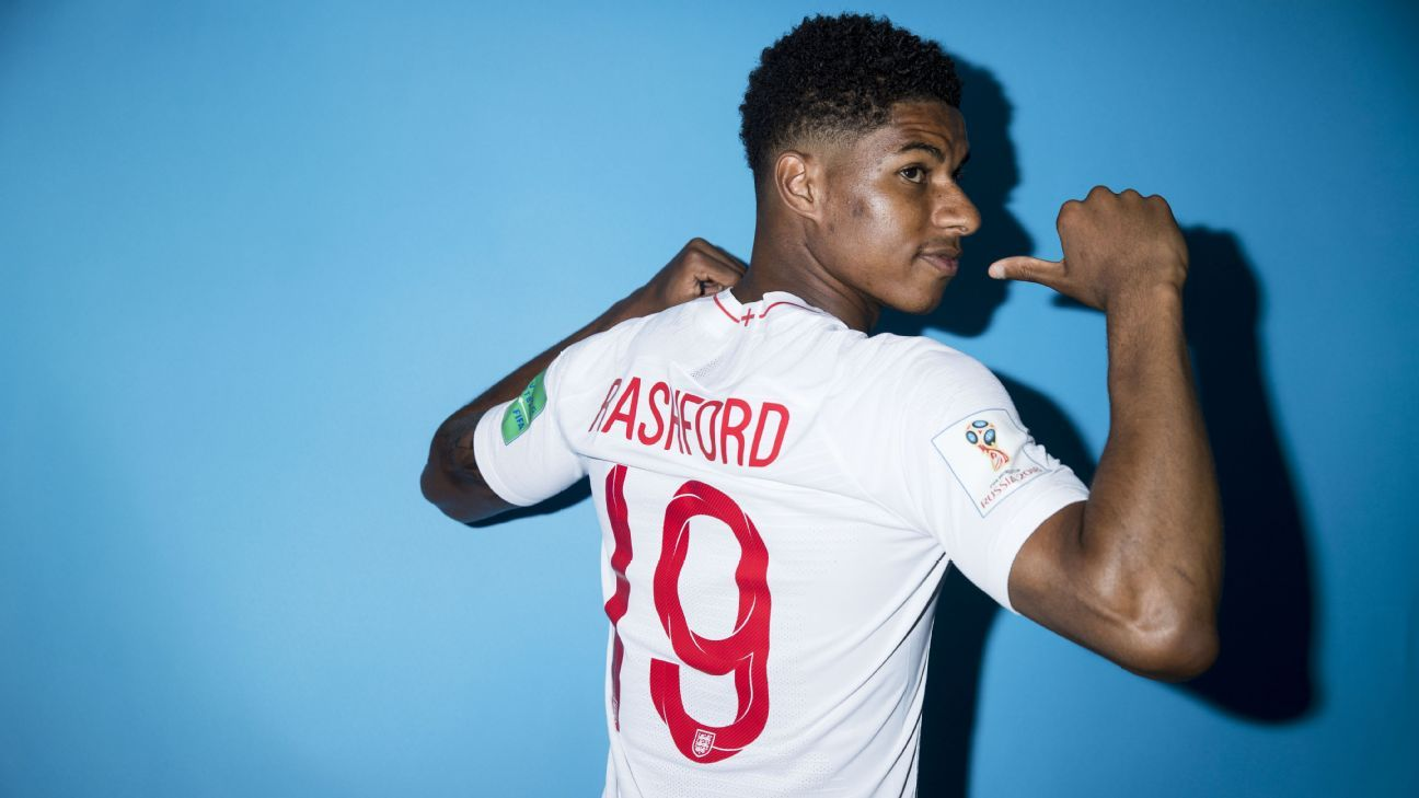 Marcus Rashford poses with his England shirt ahead of the 2018 World Cup.