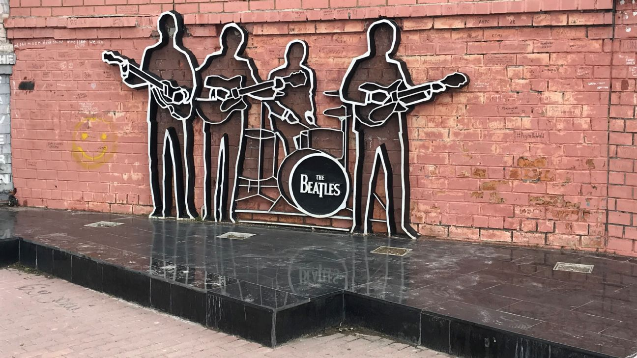The Beatles Tribute in Ekaterinburg is a wall with graffiti, sketches and a cutout of the Fabs c.1964.
