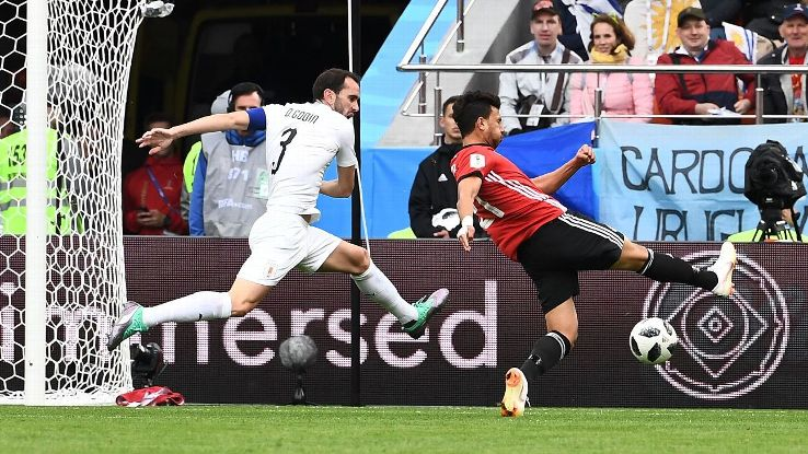 Trezeguet tries to shoot as Diego Godin closes him