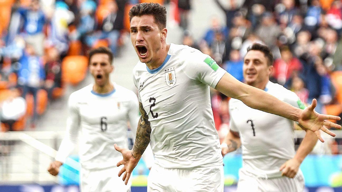 Jose Gimenez of Uruguay celebrates after scoring his team's winner.