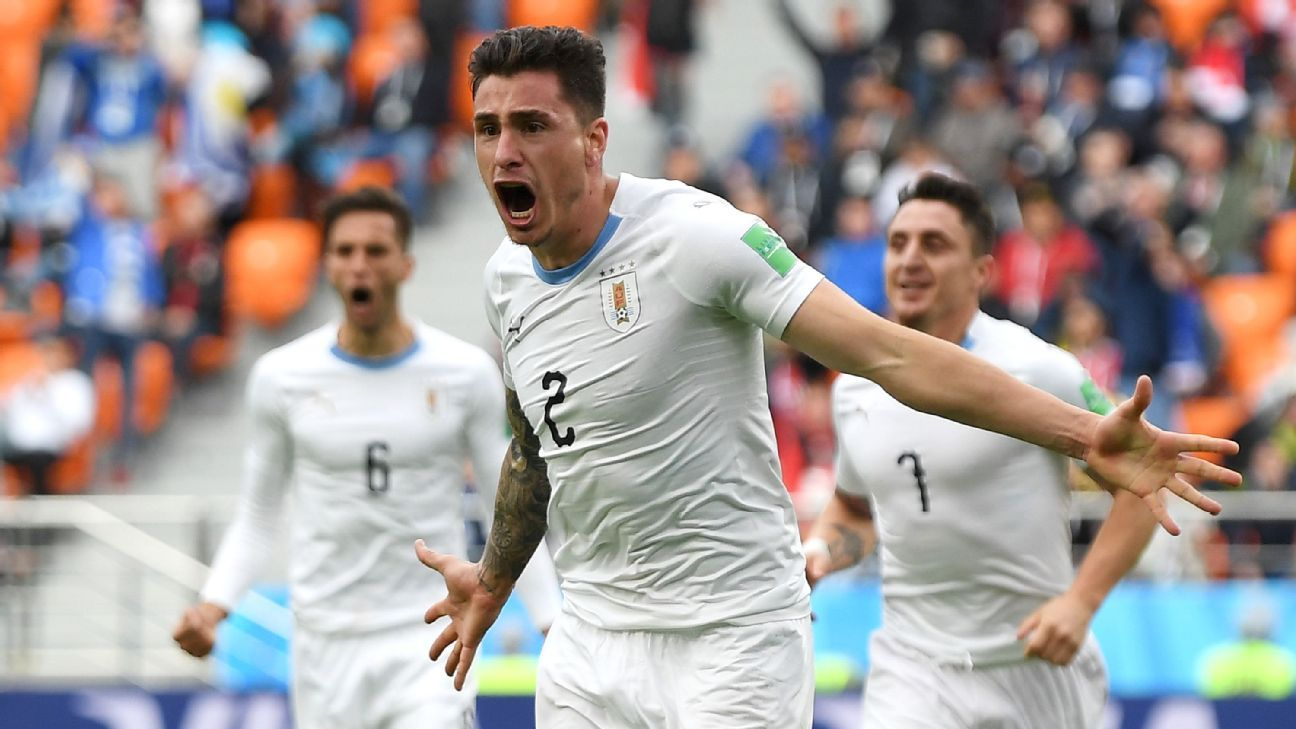 Jose Gimenez celebrates after scoring Uruguay's last-minute winner against Egypt.