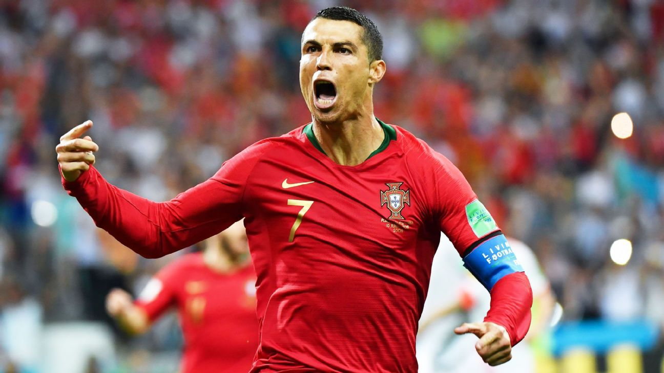 Portugal's forward Cristiano Ronaldo celebrates a goal after shooting a penalty kick during the Russia 2018 World Cup Group B football match between Portugal and Spain at the Fisht Stadium in Sochi on June 15, 2018.