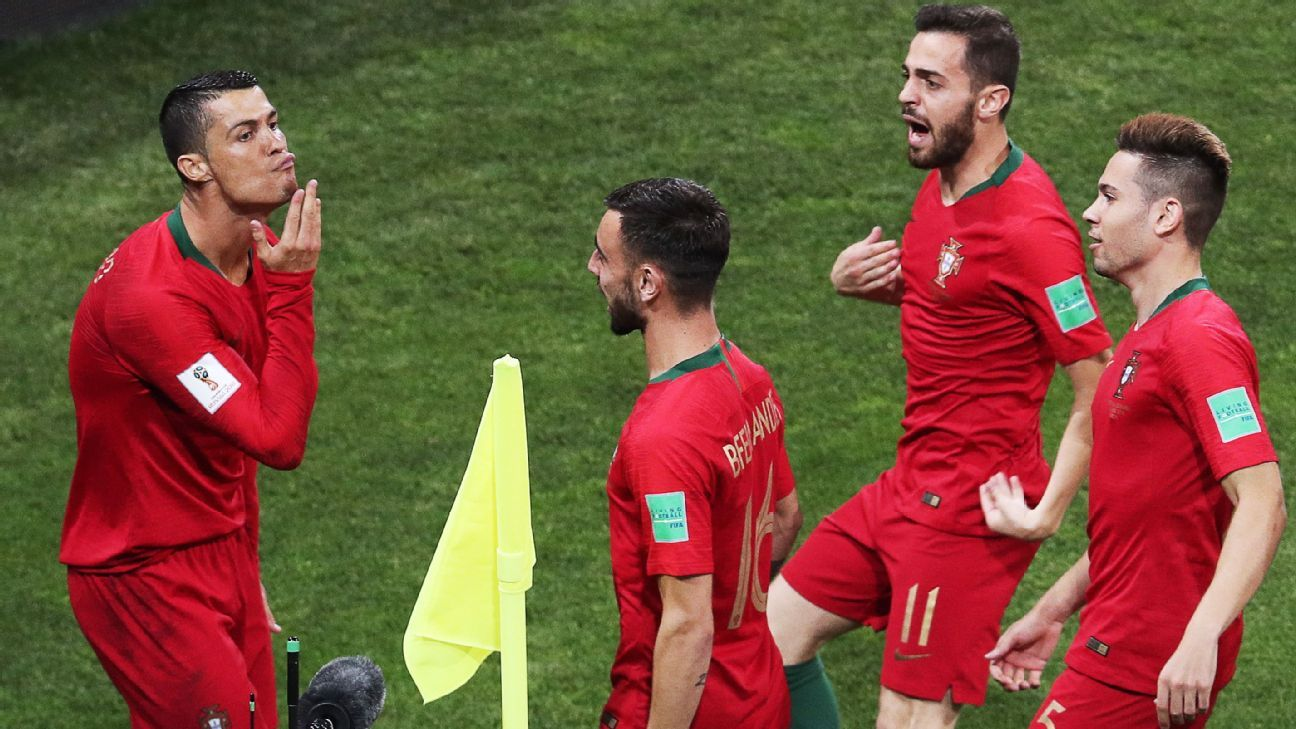 Cristiano Ronaldo strokes his chin after scoring the first of his three goals for Portugal against Spain.