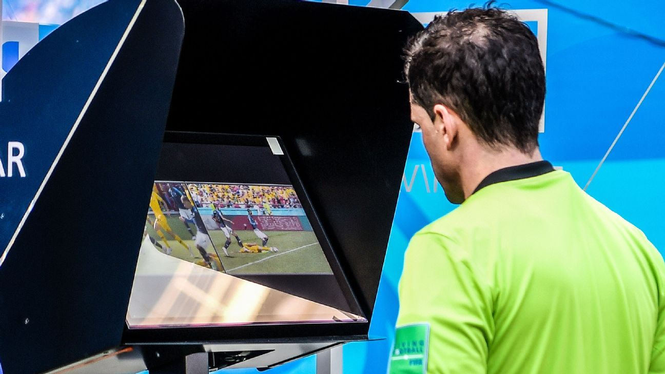 Andres Cunha, the match referee, reviews the VAR footage.