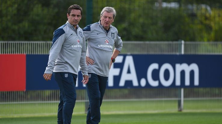 Gary Neville, left, during his time as England assistant manager to Roy Hodgson, right.