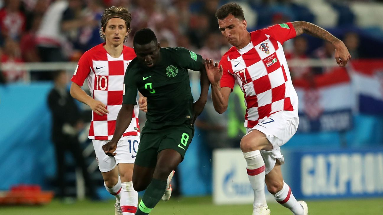 Mario Mandzukic and Luka Modric of Croatia, and Oghenekaro Etebo of Nigeria