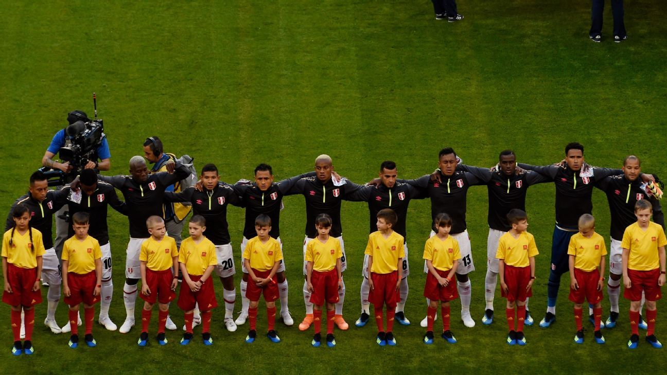 Peru's team sings the national anthem ahead of their World Cup game against Denmark.