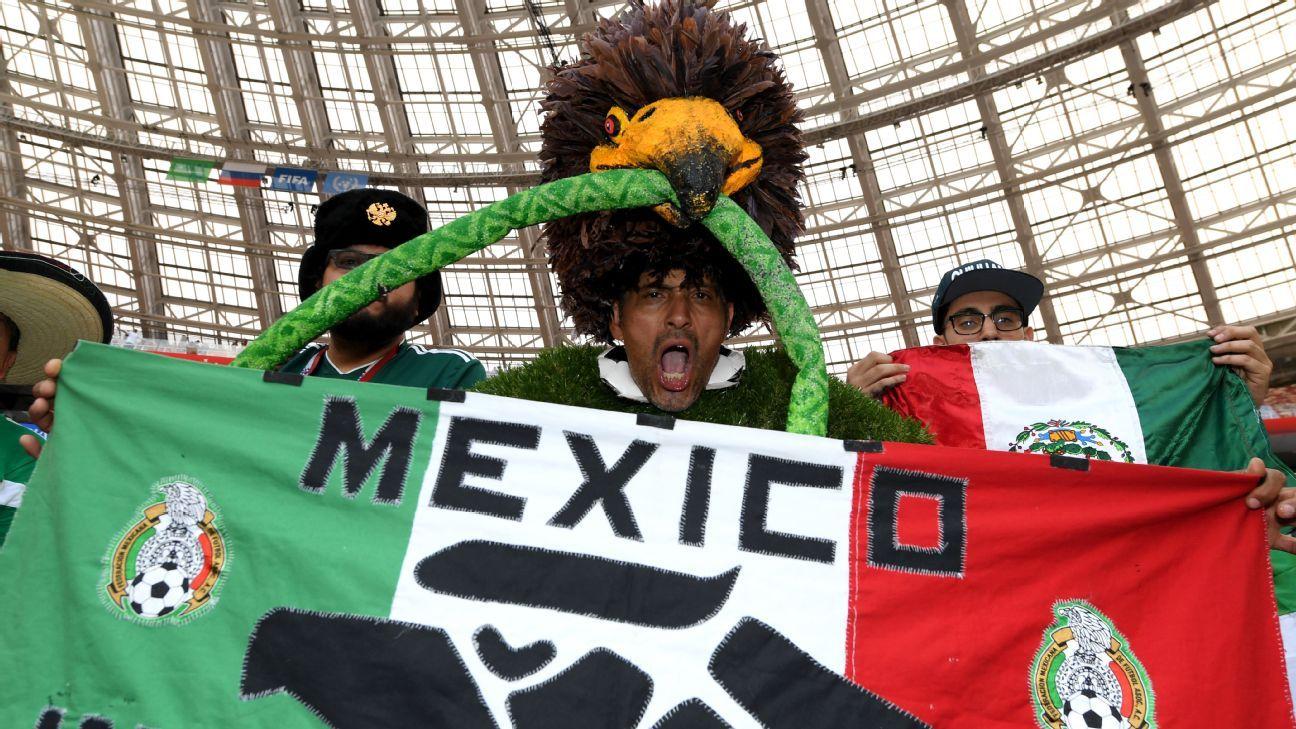 A Mexico fan enjoys the pre match atmosphere