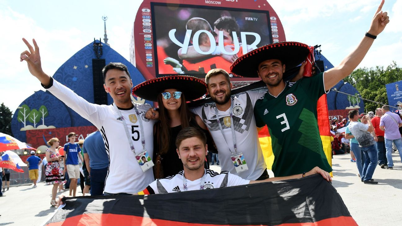 Germany and Mexico fans enjoy the World Cup.