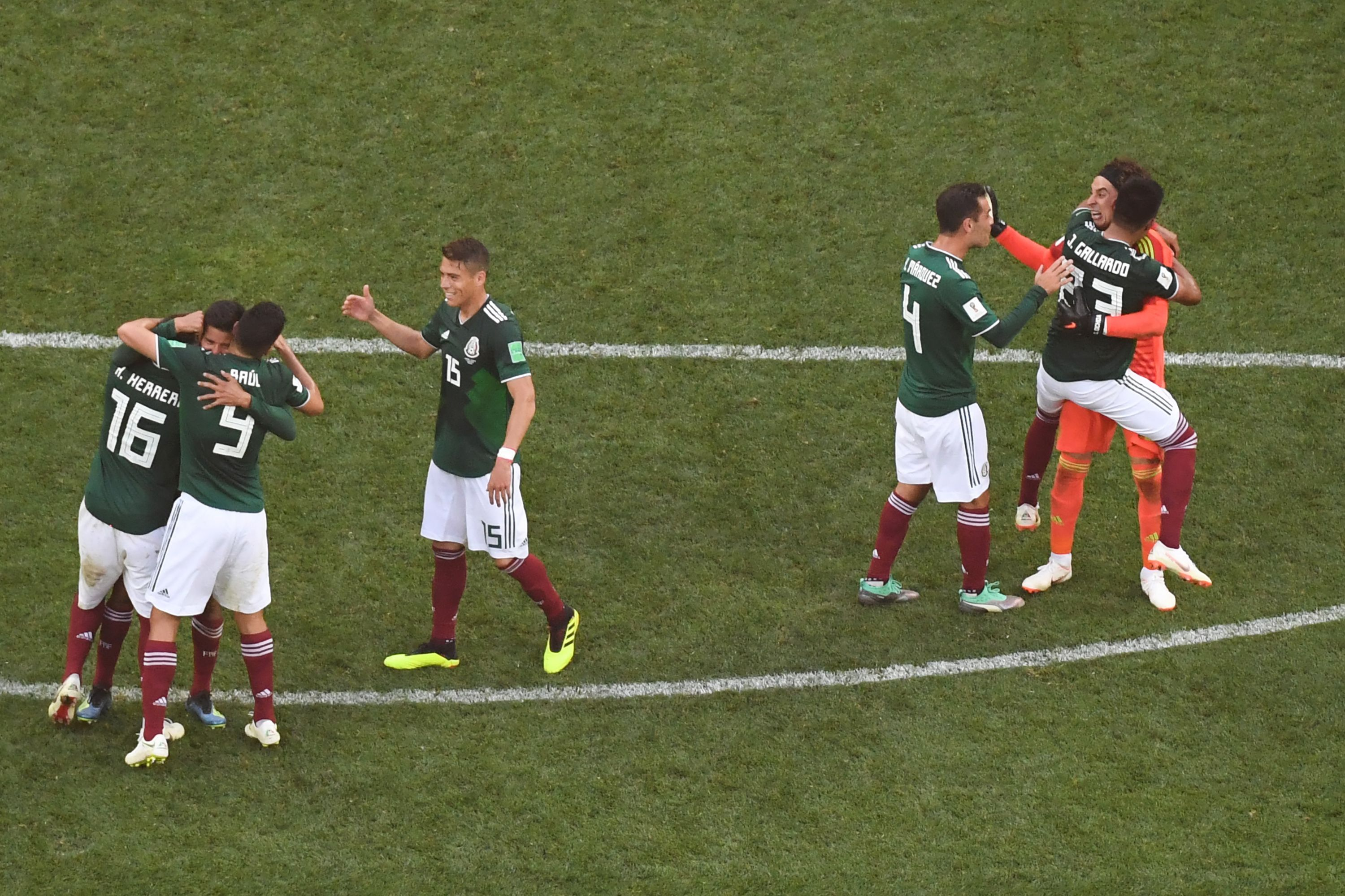 Mexico's players celebrate their historic victory with star goalkeeper Guillermo Ochoa.
