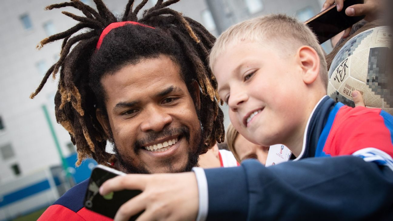 Panama captain Roman Torres poses with a fan during the team's practice session.