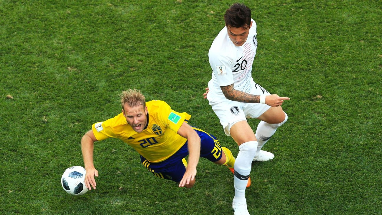 NIZHNIY NOVGOROD, RUSSIA - JUNE 18: Ola Toivonen of Sweden goes down after a tackle from Jang Hyun-Soo of South Korea during the 2018 FIFA World Cup Russia group F match between Sweden and Korea Republic at Nizhniy Novgorod Stadium on June 18, 2018 in Niz