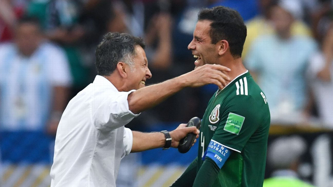 Mexico coach Juan Carlos Osorio celebrates the win over Germany with midfielder Rafael Marquez.