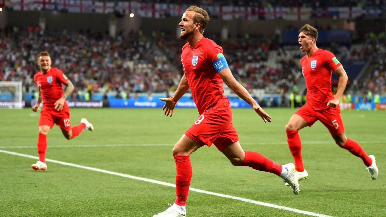 Harry Kane of England celebrates after scoring his team's first goal.