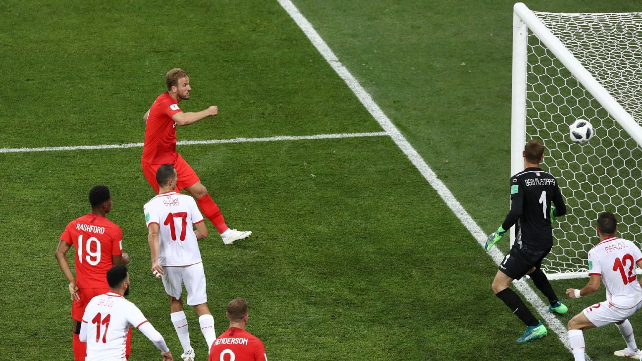 Harry Kane heads in past Farouk Ben Mustapha of Tunisia to score England's winner.