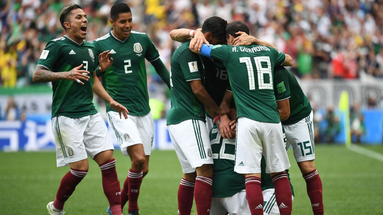 Mexico players celebrate Hirving Lozano's goal during their World Cup win against Germany.