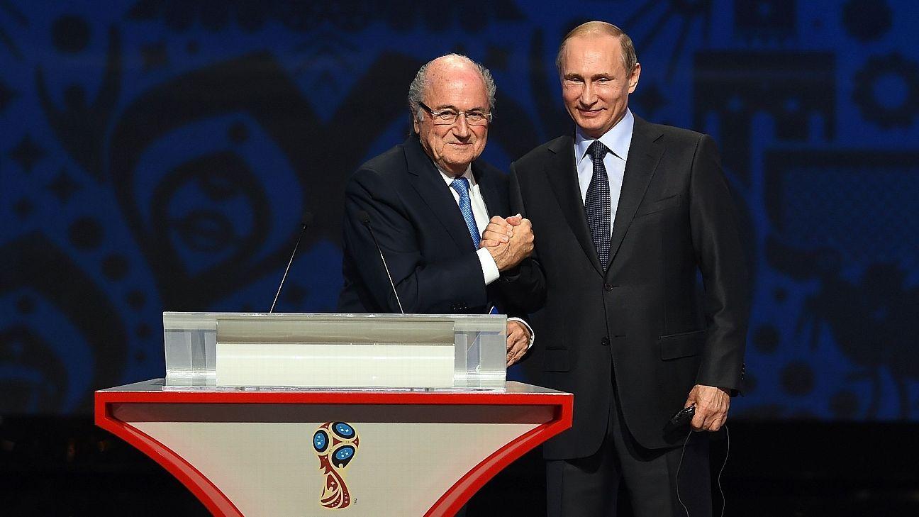Former FIFA president Sepp Blatter left, and Russia president Vladimir Putin.