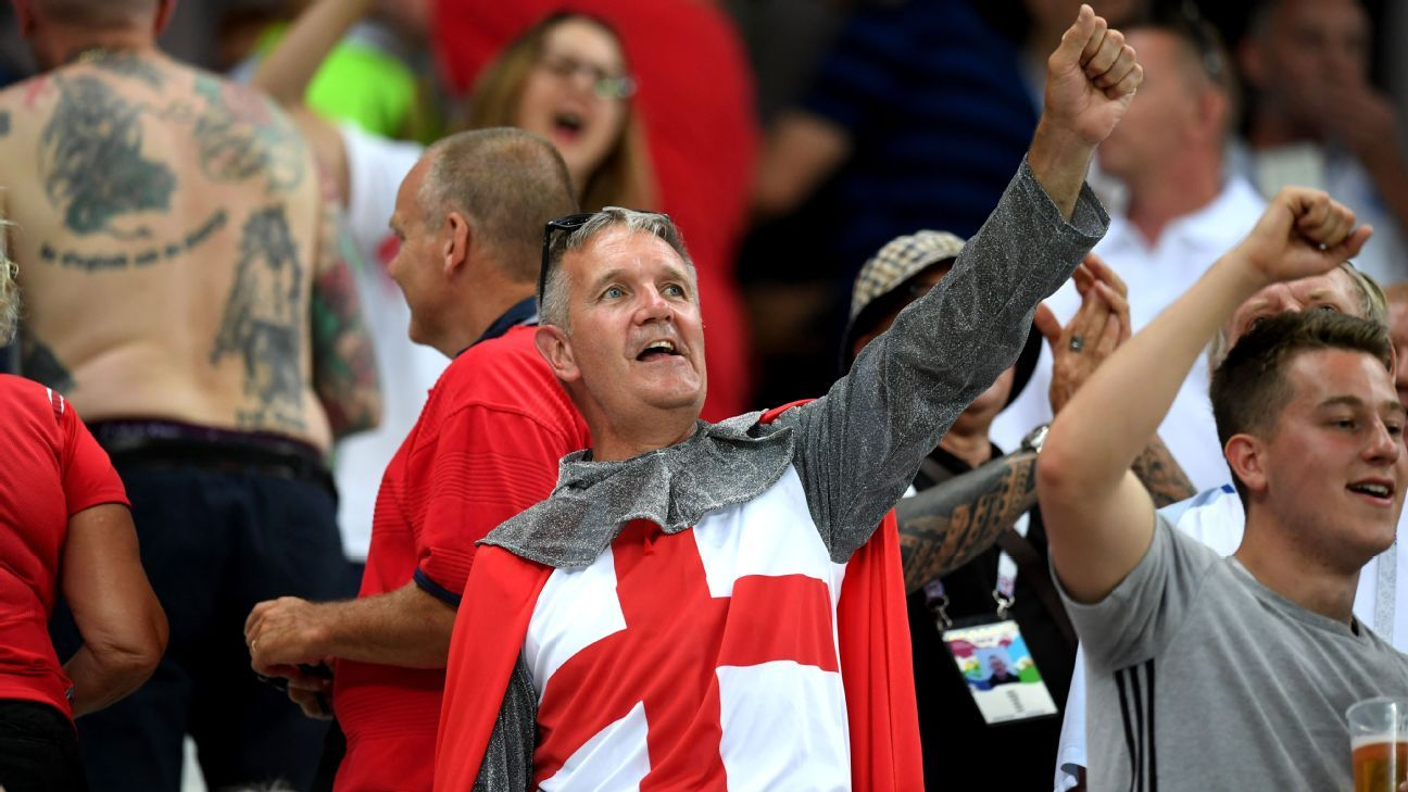 An England fan  enjoys the pre match atmosphere.
