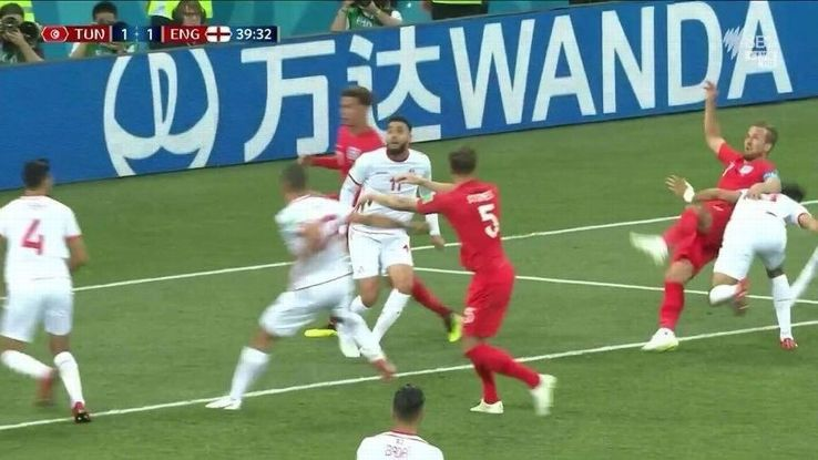 John Stones has pushed Ellyes Skhiri in the back just before the foul on Harry Kane.