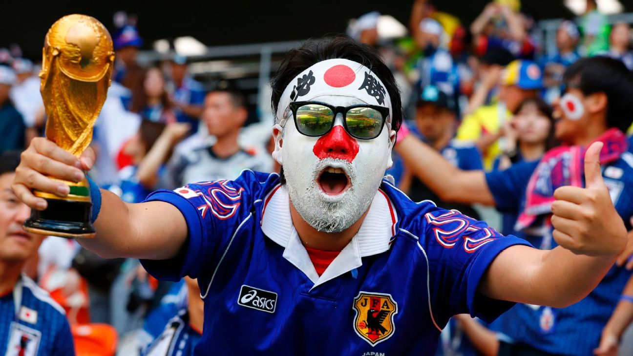 A Japan fan cheers before the game against Colombia.