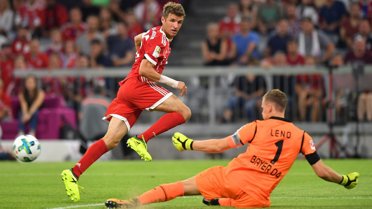 Leverkusen's Bernd Leno denies Bayern Munich's Thomas Muller during their 2017-18 Bundesliga match