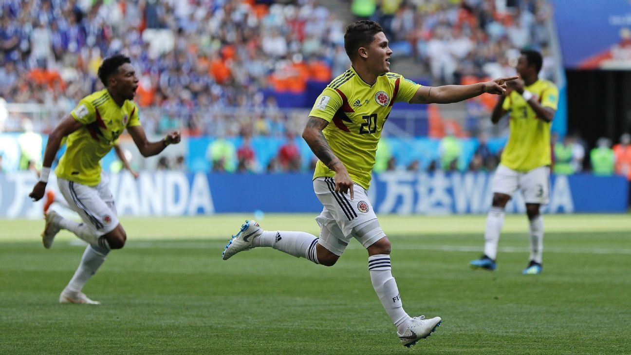 Juan Quintero celebrates after scoring in Colombia's World Cup opener against Japan.