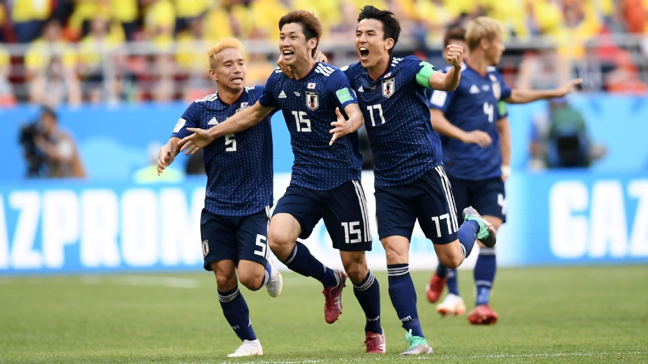 Yuya Osako of Japan celebrates scoring against Colombia.