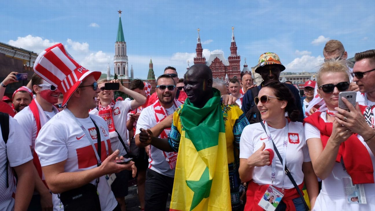 Fans of Poland and Senegal celebrate