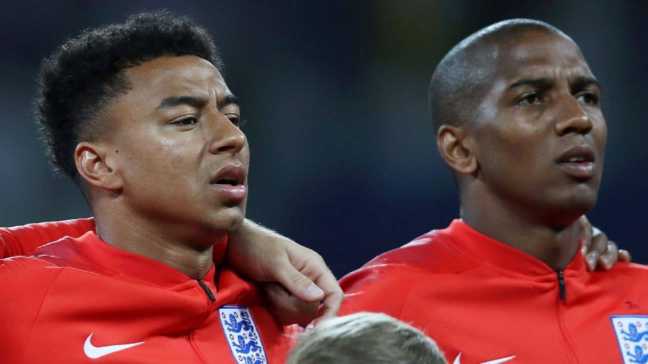 Jesse Lingard and Ashley Young stand for the anthems prior to England's World Cup group-stage win over Tunisia.