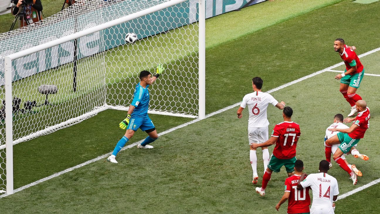 Cristiano Ronaldo heads Portugal in front against Morocco.