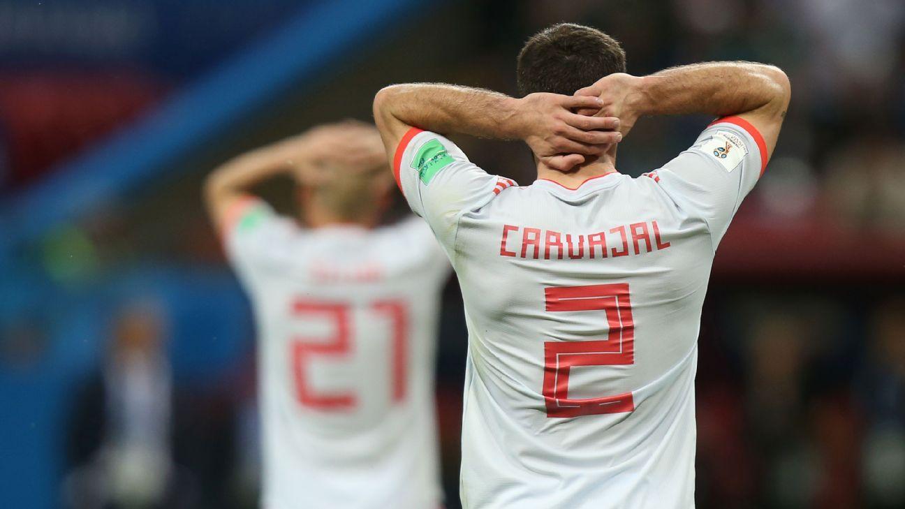 Dani Carvajal and David Silva react during Spain's 1-0 win over Iran.