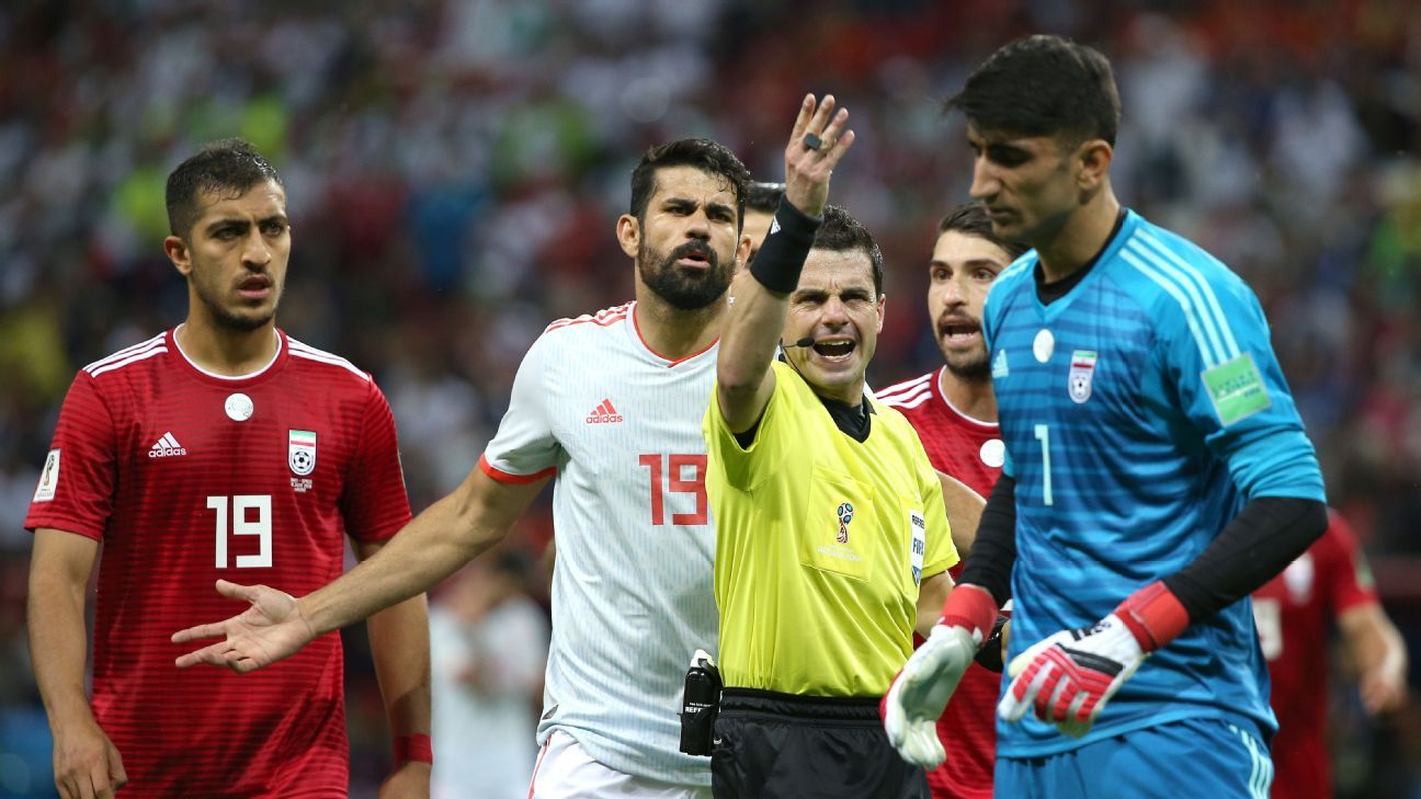 Iran and Spain players argue with the match official after a goal was disallowed for offside in their match on Wednesday.