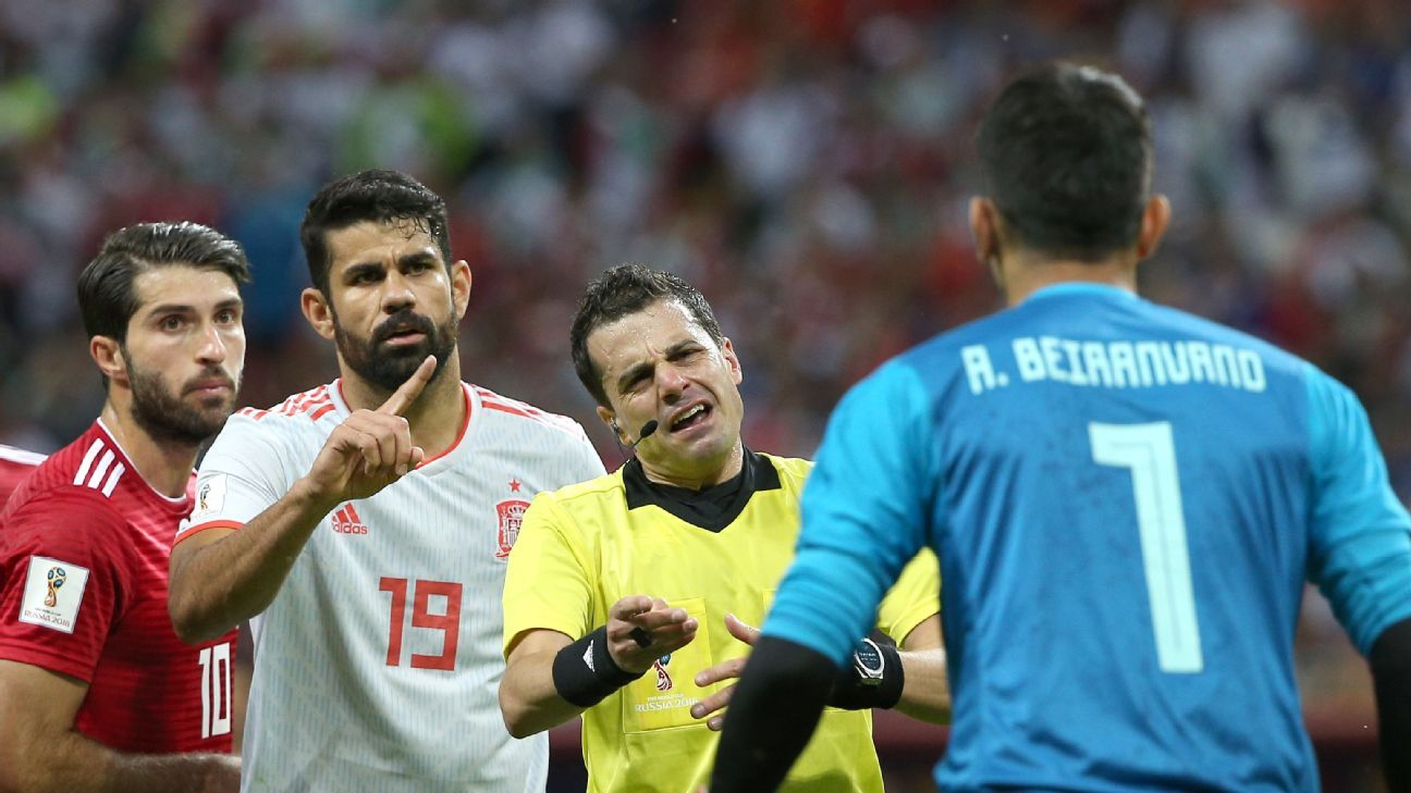 Spain's Diego Costa shouts at Iran goalkeeper Ali Beiranvand.