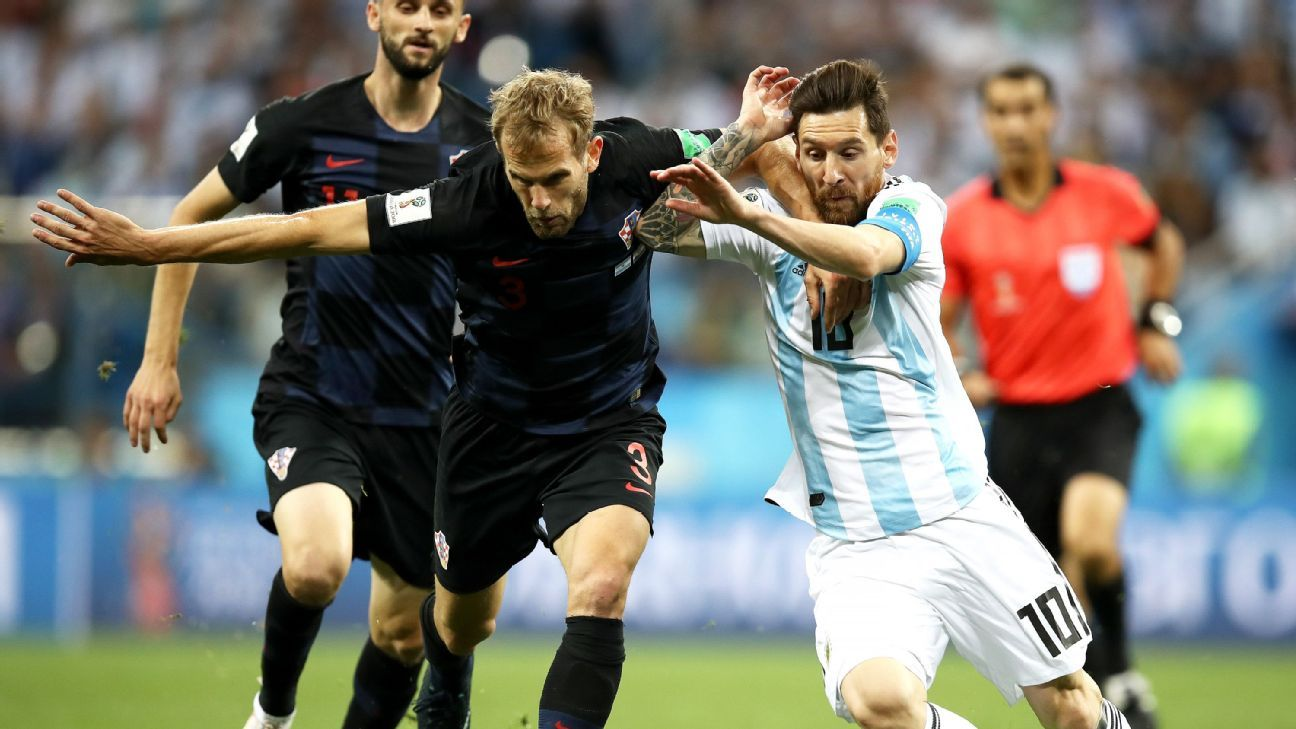 Croatia's Ivan Strinic battles for possession with Lionel Messi.