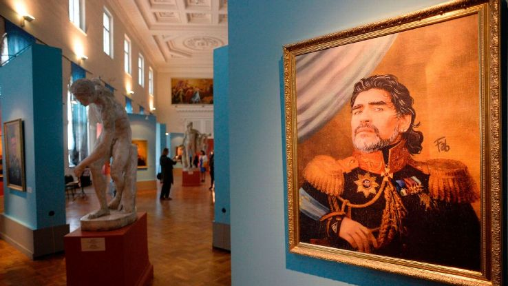 A portrait of Argentina's legend Diego Maradona is on display during the opening of the Art Project 'Like the Gods', presented by the Museum of the Russian Academy of Arts and Italian artist Fabrizio Birimbelli in Saint Petersburg, on June, 20, 2018.
