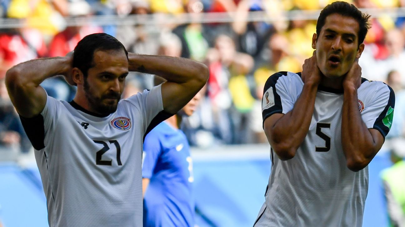 Costa Rica's midfielder Celso Borges (r) reacts after a missed chance.